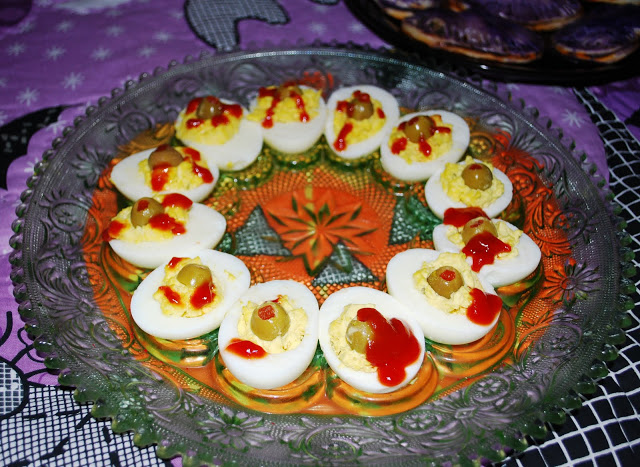 Halloween Food includes deviled eggs with ketchup for bloodshot eyes.