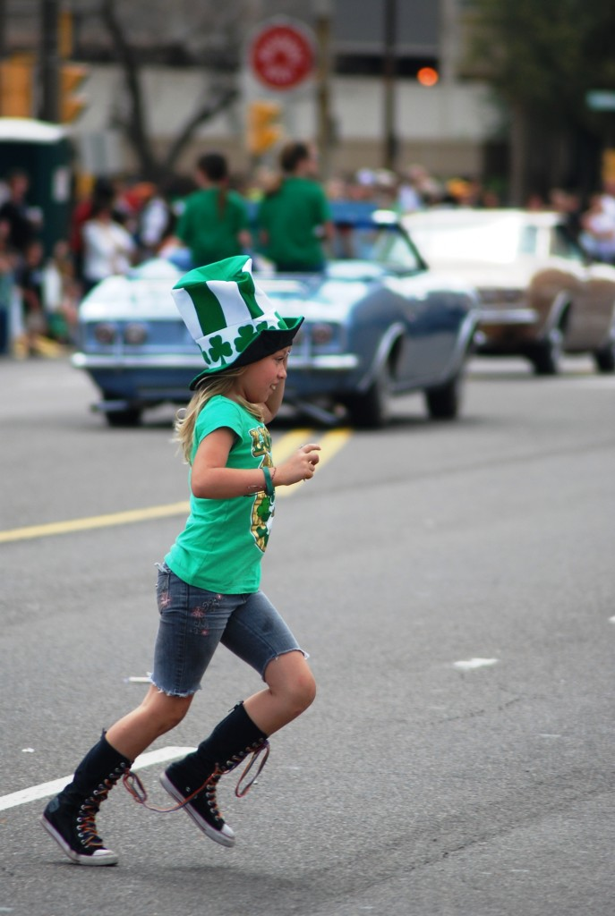 Kid chasing Candy at parade