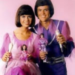 Jennifer Playing with Donny and Marie Dolls