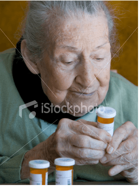 Stock Photo: Silent Generation Reading Pill Bottle