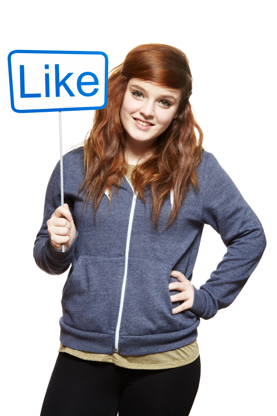 Teenage girl holding a social media sign smiling