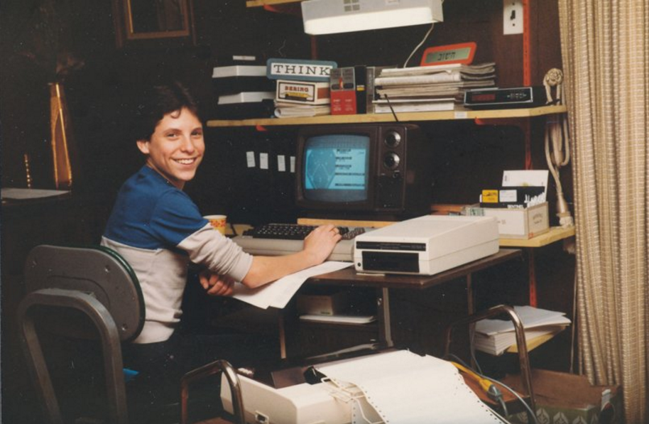 Happy playing an early video game, 1984. Photo by Barry Rich
