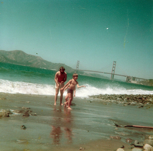 Father and children playing on a California Beach 1970s