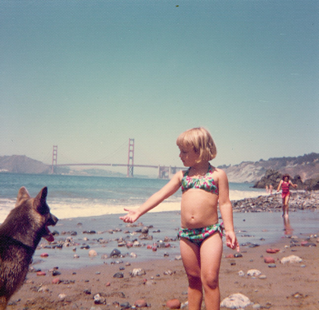 Girl and her dog at the beach, 1975