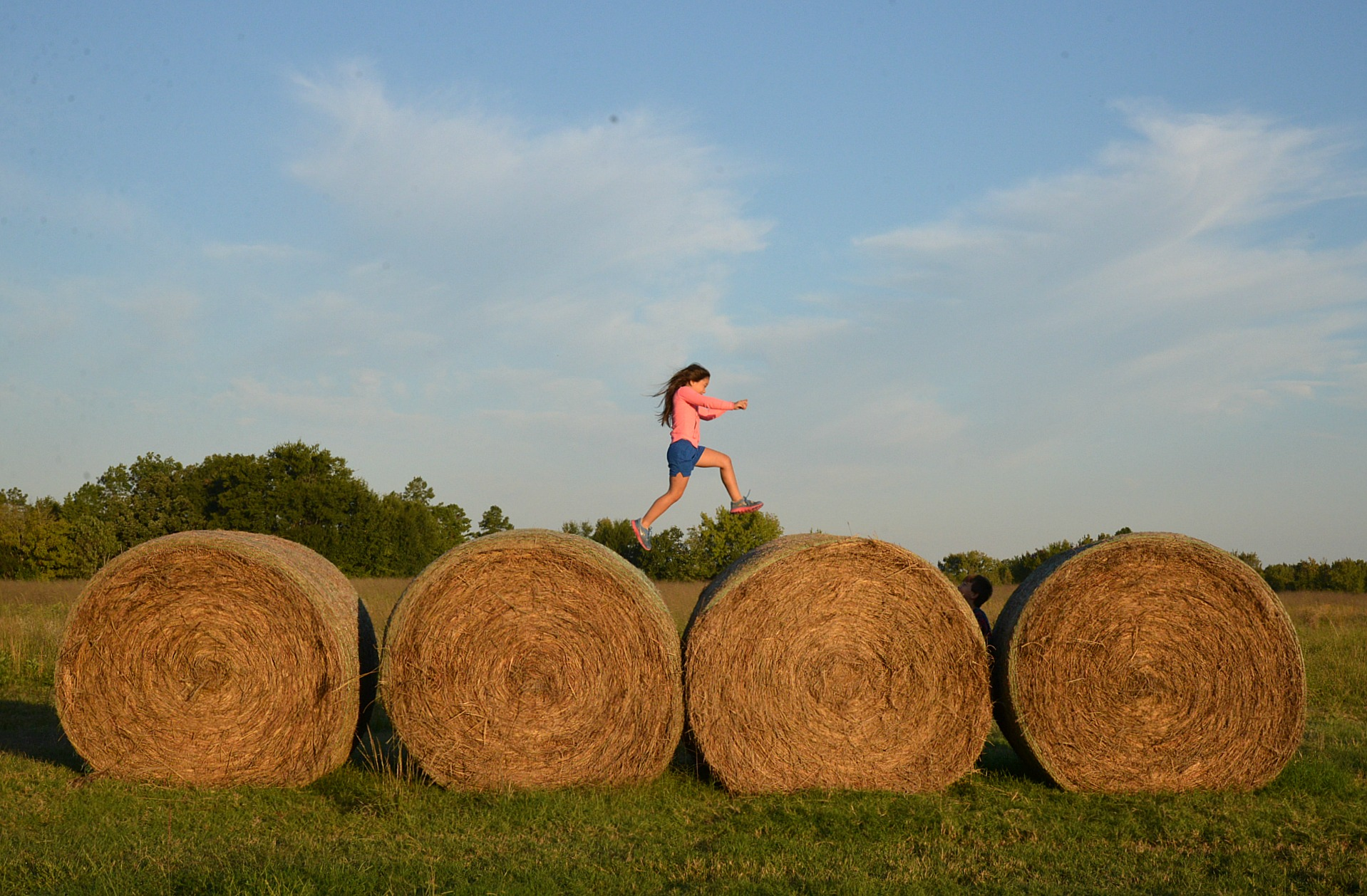 Jumping Hay Bales In East Texas Jennifer Mccollum - Bales