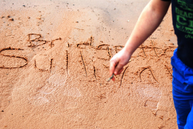 Names drawn in the sand