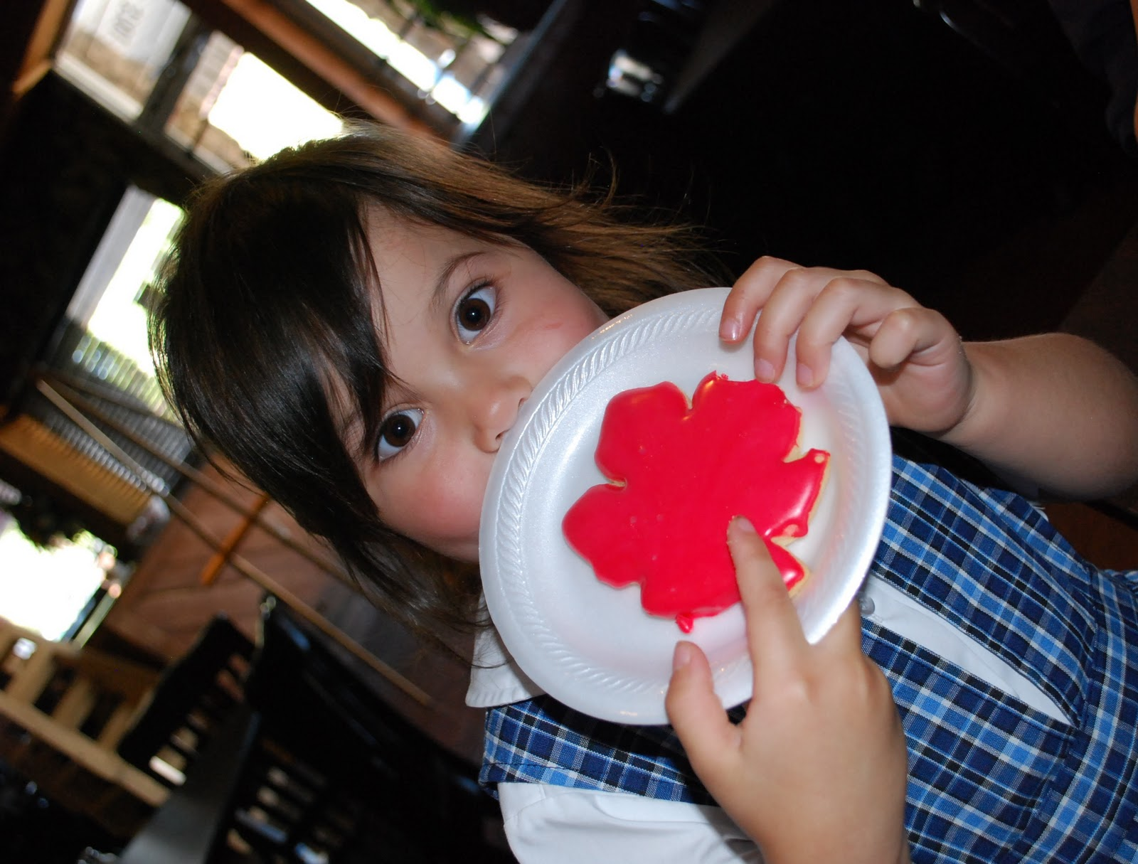 Little Bridgy chose a red frosted cookie from Ingrid's