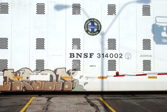 Block style graffiti on a train
