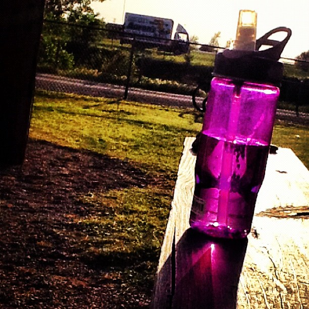 Sunlight through a purple water bottle
