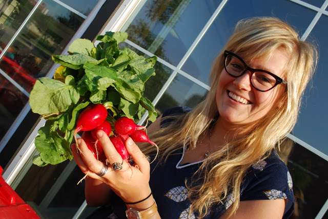 Blonde girl holds French Breakfast Radishes