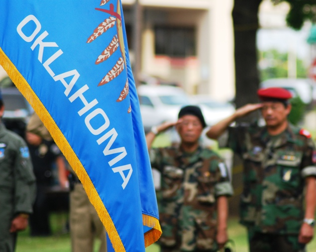 Former South Vietname Soldiers Salute the U.S. and Oklahoma Flag