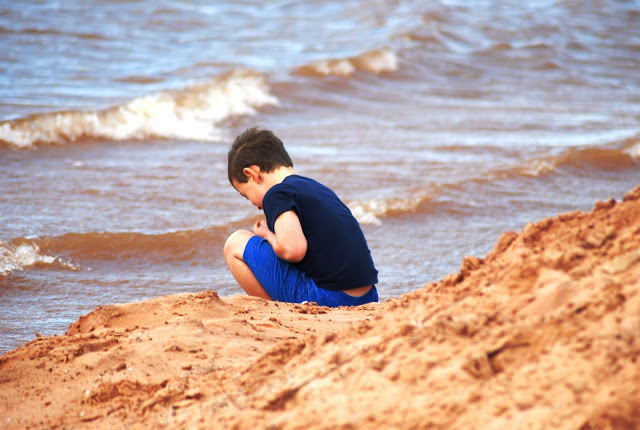 Little Boy on Shore of Lake Thunderbird