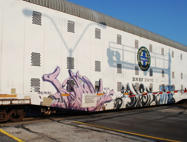 sharp and wildstyle graffiti on a train