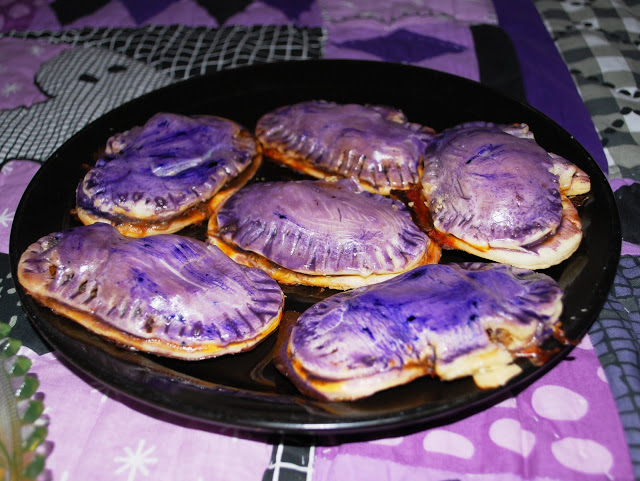 Pumpkin Pizzas painted with food coloring and egg yolks.