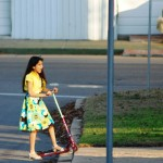 Girl in a Dress on a Scoote