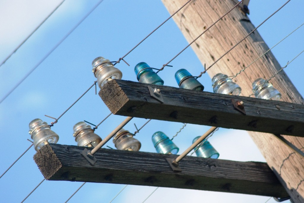Antique glass insulators and a bygone era with pictures for Vintage glass telephone pole insulators
